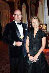 HRH PRINCE ROBERT OF LUXEMBOURG and his wife HRH PRINCESS JULIE OF LUXEMBOURG at a dinner hosted by HRH Prince Robert of Luxembourg in celebration of the 75th anniversary of the acquisition of Chateau Haut-Brion by his great-grandfather Clarence Dillon held at Lancaster House, London on 10th June 2010.