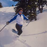 Nancy Burke telemarks at Copper Mountain Ski Area, Colorado.