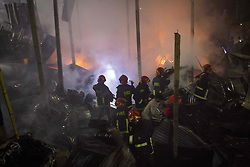 March 23, 2019 - Dhaka, Bangladesh - In the morning darkness firefighters try to control a fire which broke out at a paper warehouse at Lalbagh in Old Dhaka, Bangladesh. Recently on February 20, 2019 more than 70 people were killed when a massive fire spread through several apartment buildings in Bangladesh's capital. (Credit Image: © Zakir Hossain Chowdhury/ZUMA Wire)
