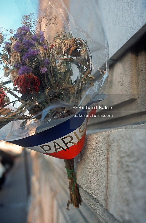 Detail of a bouquet of dying flowers, gathered for a local memorial to a killed French Resistance fighter during German-occupied WW2, on 26th April 2008, in Paris France. (Photo by Richard Baker / In Pictures via Getty Images)