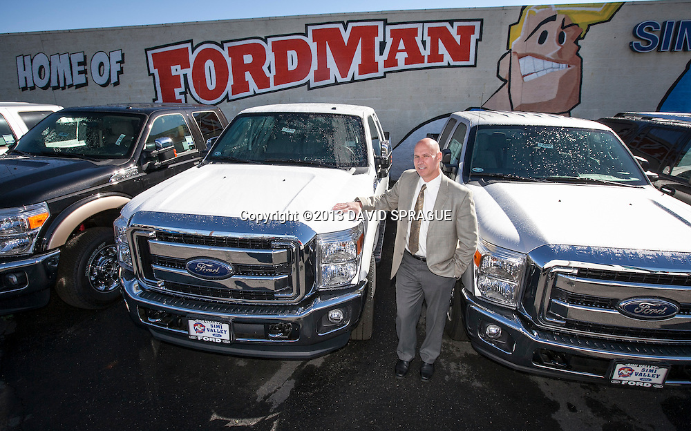 Mike Shell, Fleet Manager at Simi Valley Ford poses by some Ford trucks at the dealership. The dealership is running a campaign through Earth Day on April 22 in which the company will make a two-year carbon offset donation to carbonfund.org for every car purchased. Shot Feb. 19th,  2013 Photo by David Sprague ©2013