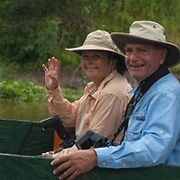 Adventure travelers ride a small motorboat up the Yanayacu River in Peru's Amazon Jungle.