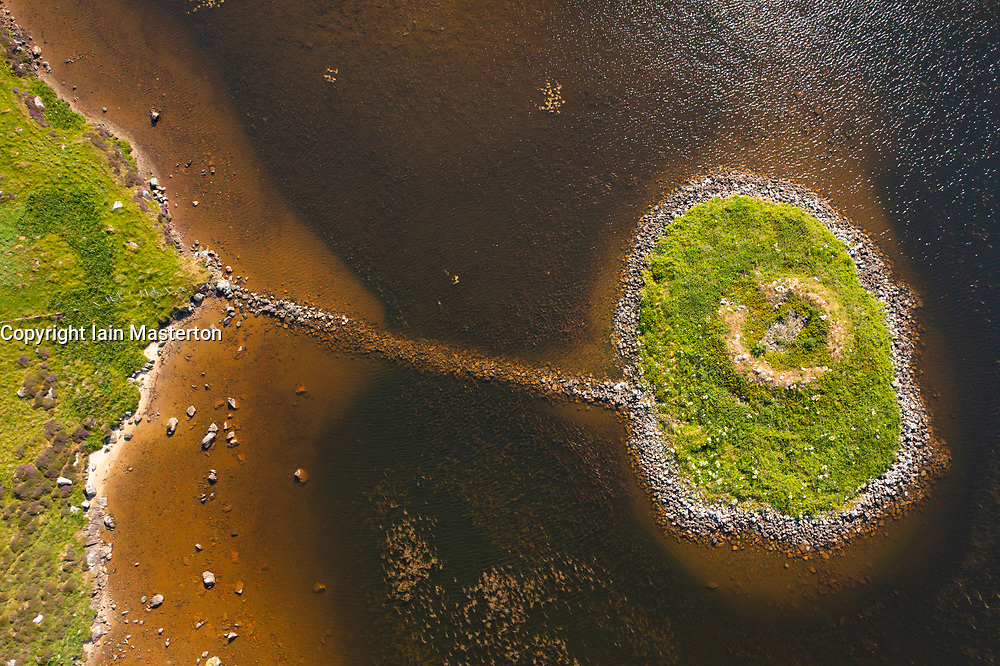 Aerial view from drone of ruin of Dun Mor broch on island in South Uist, Outer Hebrides, Scotland, UK