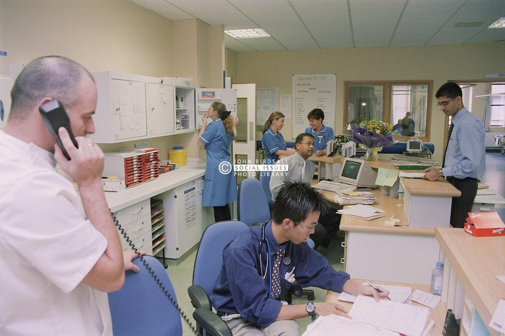 Medical staff at workstation on ENT ward in hospital,