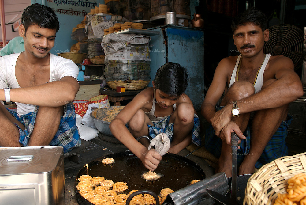 A young boy on one of the lanes of the old city in Jaipur picks up the methods of making IMRATHI, a sweet delicacy made out of pulces (Urad ki Dal)