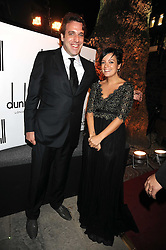 Pianist and jazz virtuoso GONZALES (Real name Jason Charles Beck) and LILY ALLEN at a party to celebrate the opening of the new home of Alfred Dunhill at Bourdon House, 2 Davies Street, London on 16th September 2008.