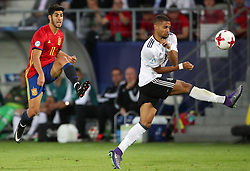 Spain's Marco Asensio (left) shoots for goal as Germany's Jeremy Toljan attempts to block