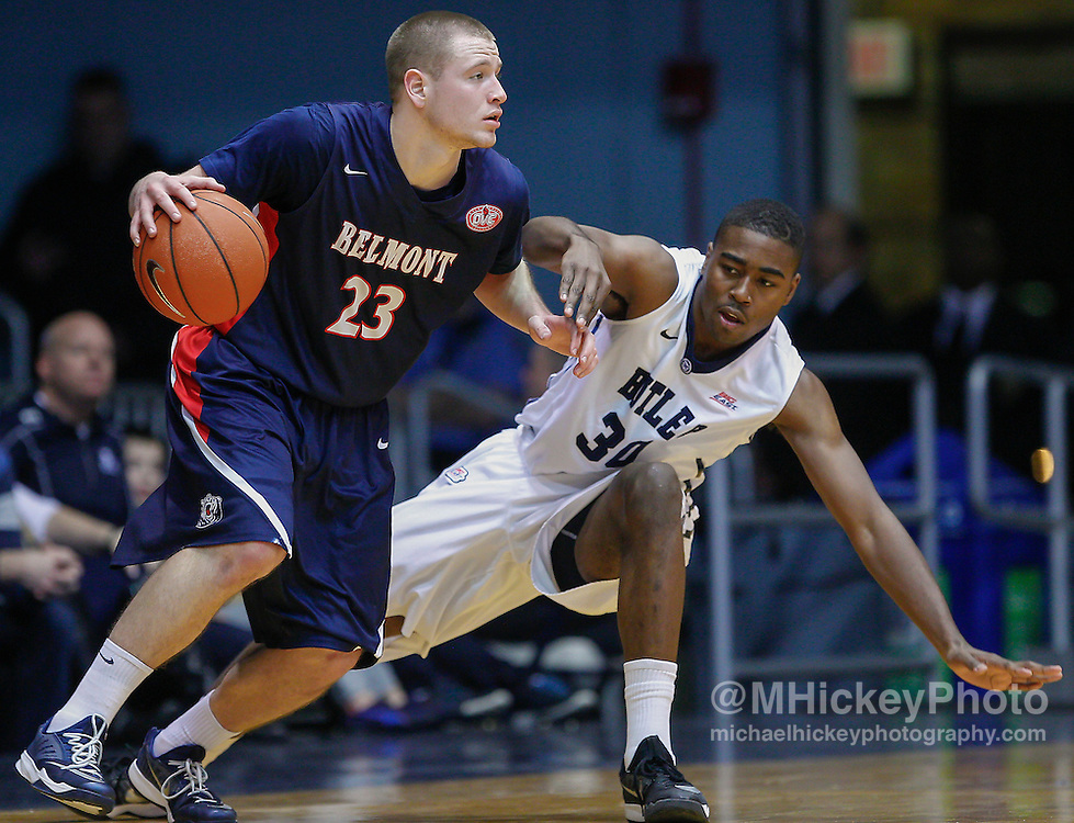 INDIANAPOLIS, IN - DECEMBER 28: Craig Bradshaw #23 of the Belmont Bruins dribbles the ball around Kelan Martin #30 of the Butler Bulldogs at Hinkle Fieldhouse on December 28, 2014 in Indianapolis, Indiana. (Photo by Michael Hickey/Getty Images) *** Local Caption *** Craig Bradshaw; Kelan Martin
