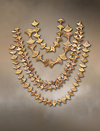 Mycenaean gold necklaces from the Mycenae chamber tombs, Greece. National Archaeological Museum Athens.<br /> <br /> From top to bottom: <br /> <br /> Top four  necklaces in the shape of papyrus flowers .<br /> <br /> Fifth necklace down in the shape of Ivy leaves from tomb 91 Cat No 3186 .<br /> <br /> If you prefer to buy from our ALAMY PHOTO LIBRARY  Collection visit : https://www.alamy.com/portfolio/paul-williams-funkystock/mycenaean-art-artefacts.html . Type -   Athens    - into the LOWER SEARCH WITHIN GALLERY box. Refine search by adding background colour, place, museum etc<br /> <br /> Visit our MYCENAEN ART PHOTO COLLECTIONS for more photos to download  as wall art prints https://funkystock.photoshelter.com/gallery-collection/Pictures-Images-of-Ancient-Mycenaean-Art-Artefacts-Archaeology-Sites/C0000xRC5WLQcbhQ