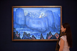 © Licensed to London News Pictures. 31/05/2013. London, UK. A Bonhams employee is seen with 'Madonna Laboris' (est. GB£800,000-1,200,000) a 1931 painting by Nicholas Roerich at the press view for a sale of Russian art in London today (31/05/2013). The Russian sale, one of two held each year by Bonhams dedicated Russian Department  is set to take place on Wednesday the 5th of June.. Photo credit: Matt Cetti-Roberts/LNP