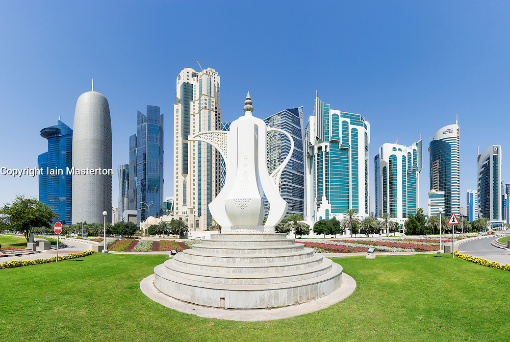 View of modern office towers and coffee pot sculpture landmark  in West Bay financial and business district in Doha Qatar