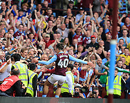 Jack Grealish of Aston Villa (c) celebrates with the Villa fans after he  scores his teams 3rd goal .EFL Skybet championship match, Aston Villa v Rotherham Utd at Villa Park in Birmingham, The Midlands on Saturday 13th August 2016.<br /> pic by Andrew Orchard, Andrew Orchard sports photography.