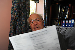 An elderly man is worried about paying his bills, MODEL RELEASED