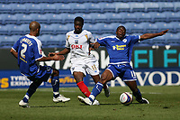 Photo: Pete Lorence.<br />Leicester City v Portsmouth. Pre Season Friendly. 04/08/2007.<br />Sean Newton slides in on Arnold Mvuemba.