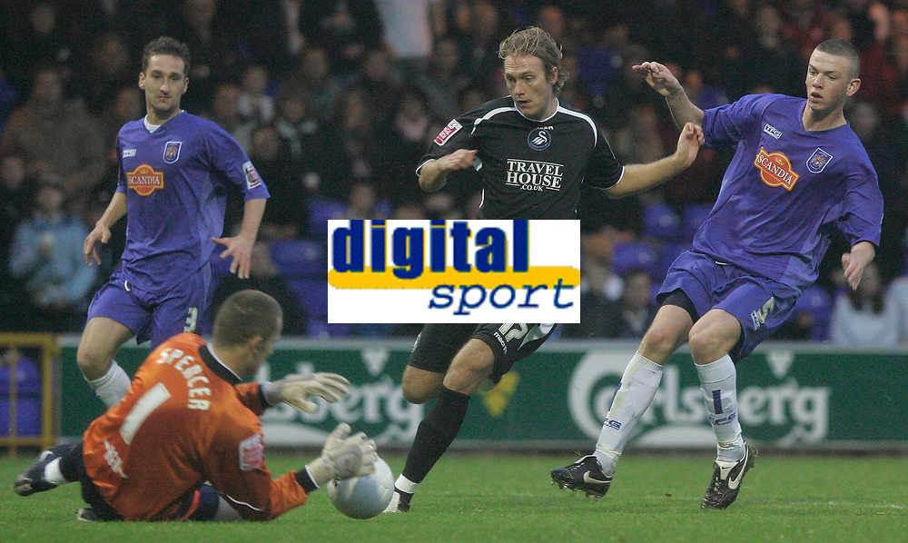 Photo: Dave Howarth.<br />Stockport County v Swansea City. The FA Cup.<br />05/11/2005.  Swansea's Paul Connor (C), under preasure from Stockport's Michael Raynes, shoots straight at the keeper James Spencer