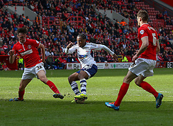 Bolton Wanderers' Neil Danns under pressure from Charlton Athletic's Morgan Fox and Dorian Dervite - Photo mandatory by-line: Robin White/JMP - Tel: Mobile: 07966 386802 18/04/2014 - SPORT - FOOTBALL - The Valley - Charlton - Charlton Athletic v Bolton Wanderers - Sky Bet Championship