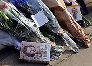 © Licensed to London News Pictures. 08/04/2013. London, UK Books and flowers signed by a well wishers. Flowers left at the house where former Conservative Prime Minister Margaret Thatcher lived in central London. Lady Thatcher dies this mooring from a suspected stroke. Photo credit : Stephen Simpson/LNP
