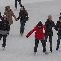 People enjoy skating on a public ice rink inter in a park in Budapest, Hungary on February 17, 2012. ATTILA VOLGYI