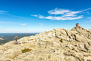 Black Elk Peak, formerly Harney Peak. Photo taken September 30, 2017, shows lookout, built by CCC in 1939 and now listed in the National Register of Historic Places. Harney Peak elevation is 2207 meters, or 7242 feet, the highest point east of the rocky mountains and west of the Pyrenees Mountains of Europe.