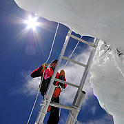 Ed Viesturs climbs a ladder in the Khumbu Icefall during a day of practice and training.