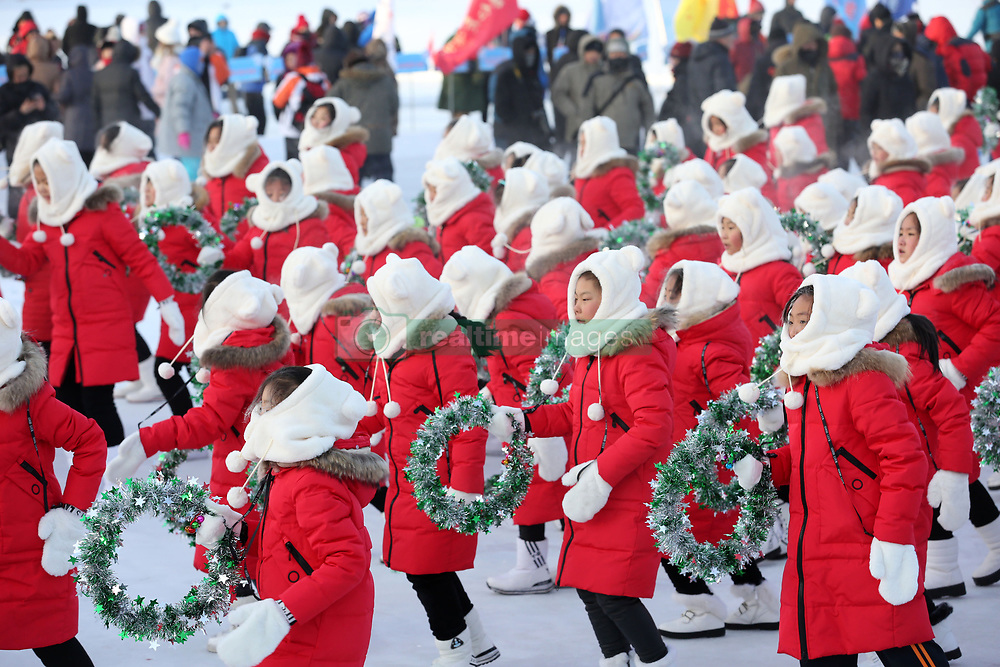 January 1, 2018 - Heilongjian, Heilongjian, China - Heilongjiang, CHINA-1st January 2018:(EDITORIAL USE ONLY. CHINA OUT) ..Students dance under the temperature of minus 37 degree Celsius in Daxinganlin, northeast China's Heilongjiang Province. (Credit Image: © SIPA Asia via ZUMA Wire)