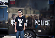 "A Chinese boy poses for a picture in front of a Police tank in Tiananmen square in Beijing, China, July 19, 2014.<br />   <br /> This picture is part of the series ""Urban Chinese Streets"", a journey on the streets of Chinese cities to discover their modern citizens and habits.      <br /> <br /> © Giorgio Perottino"