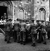 Trooper Ed Gaffney's body is removed..1961..02.10.1961..10.02.1961..2nd October 1961...Trooper Ed Gaffney's mortal remains were removed today from Dublin Airport to Arbour Hill Church. Trooper Gaffney died while on peace keeping duty with the United Nations force in the Congo..Image shows the coffin being removed from the gun carriage at the door of the church in Arbour Hill, Dublin.