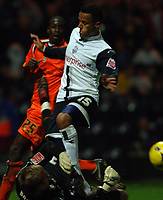 Photo: Paul Greenwood.<br />Preston North End v Luton Town. Coca Cola Championship. 04/11/2006. Luton keeper bravely saves at the feet of Preston's Simon Whalley.