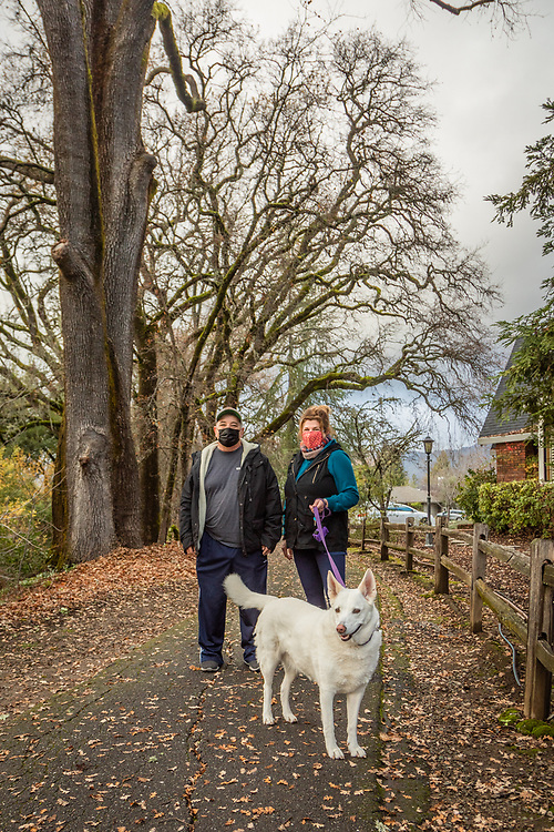"""""""We want to be around in ten years.  So, we're trying to improve the odds.  We're eating better and getting more exercise.  If we can extend our lives one more year, it will be like 2020 never happened.""""  -Ron and Linda Beltz walk with their dog, Shasta, near Heather Oaks Park in Calistoga."""