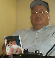 8/20/07 Lincoln, NE  Harlan Chamberlain holds a photo of his grandson, Karter Chamberlain, who is the son of  New York Yankee rookie pitcher Joba Chamberlain, Karter Chamberlain.....(Chris Machian/Prairie Pixel Group)
