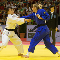 Aimi Nouchi (L) of Japan and Martyna Trajdos (R) of Germany fight during the Women -63 kg category at the Judo Grand Prix Budapest 2018 international judo tournament held in Budapest, Hungary on Aug. 11, 2018. ATTILA VOLGYI
