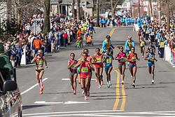 2014 Boston Marathon: lead pack of elite women led by Buzenesh Deba, hydration zone
