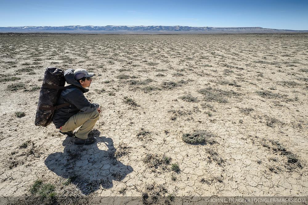 Wildlife photojournalist Noppadol Paothong trying to locate a greater sage-grouse lek in southwest Wyoming. ©John L. Dengler / DenglerImages.com