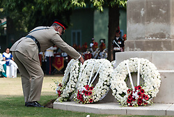 © Licensed to London News Pictures. 11/11/2012. Delhi, India. An officer of the British Army places a wreath at a memorial at a Remembrance Day ceremony held at the Delhi War Cemetery, India. Remembrance Day (also known as Poppy Day or Armistice Day) is a memorial day observed in Commonwealth countries since the end of World War I to remember the members of their armed forces who have died in the line of duty. This day, or alternative dates, are also recognized as special days for war remembrances in many non-Commonwealth countries. Remembrance Day is observed on 11 November to recall the end of hostilities of World War I on that date in 1918.   Photo credit : Richard Isaac/LNP
