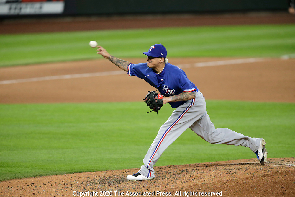 Texas Rangers relier pitcher Jesse Chavez works against the Seattle Mariners during a baseball game, Saturday, Aug. 22, 2020, in Seattle. (AP Photo/John Froschauer)
