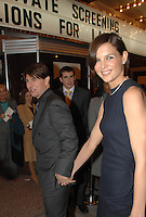 "Tom Cruie and wife Katie Holmes arrive for a screening of his new film, ""Lions for Lambs"" at the Uptown Theater in Washington, DC"