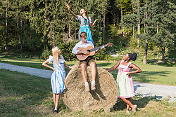 Teenage friends playing and singing music during picnic, Bavaria, Germany