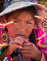 UROS ISLANDS, PERU - CIRCA APRIL 2014: Girl from the Uros Islands in Lake Titicaca.