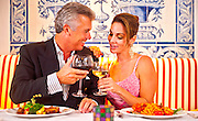 A couple enjoying a romantic diner at The Fisher Island Club and Resort.