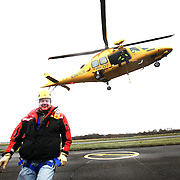 Mike Haglund, the president of the Oregon State Bar for 2013, is a maritime lawyer who represents the Columbia River Bar Pilots. The pilots, based out of Astoria, steer large ships over the treacherous Columbia bar. The bar pilots' helicopter, the purchase of which Haglund negotiated.