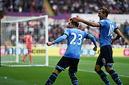 Christian Eriksen of Tottenham celebrates with Harry Kane (r) after he scores his teams 2nd goal to equalise at 2-2. . Barclays premier league match, Swansea city v Tottenham Hotspur at the Liberty Stadium in Swansea, South Wales on Sunday 4th October 2015.<br /> pic by  Andrew Orchard, Andrew Orchard sports photography.