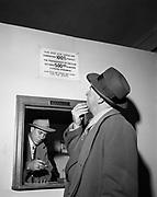 Y-490128-05.  Cashier's booth. Mike Elliot gambling raid. Ramapo Hotel basement, 1337 SW Washington January 28, 1949.