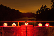 Jack o' lanterns over the Haw River. The old Bynum bridge in Bynum, North Carolina during the annual Bynum Pumpkins on the Bridge celebration.