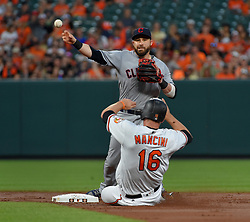 June 21, 2017 - Baltimore, MD, USA - Cleveland Indians second baseman Jason Kipnis turns a double play over the Baltimore Orioles' Trey Mancini (16) in the second inning at Oriole Park at Camden Yards in Baltimore on Wednesday, June 21, 2017. The Indians won, 5-1. (Credit Image: © Lloyd Fox/TNS via ZUMA Wire)