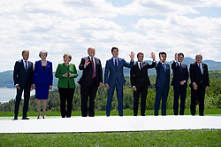 President of the European Council Donald Tusk, left to right, Prime Minister of the United Kingdom Theresa May, Chancellor of Germany Angela Merkel, President of the United States Donald Trump, Canada's Prime Minister Justin Trudeau, President of France Emmanuel Macron, Prime Minister of Japan Shinzo Abe, Prime Minister of Italy Giuseppe Conte, and President of the European Commission Jean-Claude Juncker pose for a family photograph during the G7 leaders summit in La Malbaie, Quebec, Canada on Friday, June 8, 2018. Photo by Sean Kilpatrick/CP/ABACAPRESS.COM