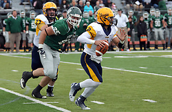 18 October 2014:  Nick Stone (OL)  attempts to stop Brady Hails from getting to Sam Frasco during an NCAA division 3 football game between the Augustana Vikings and the Illinois Wesleyan Titans in Tucci Stadium on Wilder Field, Bloomington IL