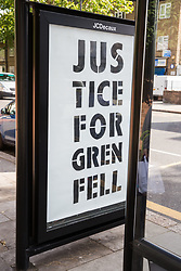 London, UK. 14 June, 2019. A Justice for Grenfell protest stencil appeared close to Grenfell Tower on the second anniversary of the Grenfell Tower fire on 14th June 2017 in which 72 people died and over 70 were injured. Credit: Mark Kerrison/Alamy Live News