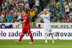 Kevin Kampl of Slovenia and Jack Wilshere of England during the EURO 2016 Qualifier Group E match between Slovenia and England at SRC Stozice on June 14, 2015 in Ljubljana, Slovenia. Photo by Grega Valancic