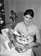 17/12/1959<br /> 12/17/1959<br /> 17 December 1959<br /> <br /> Ms. Rose Shire decorating a cake for Christmas