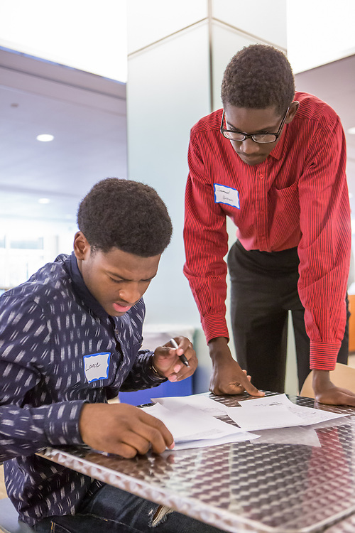 Purchase, NY – 31 October 2014. Port Chester High School student Lance Tennyson taking notes as team member Samuel Brown looks on. The Business Skills Olympics was founded by the African American Men of Westchester, is sponsored and facilitated by Morgan Stanley, and is open to high school teams in Westchester County.